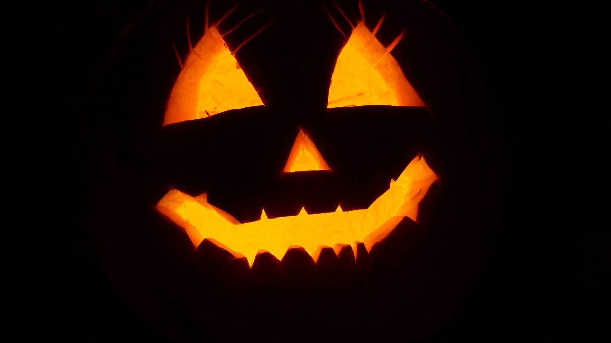 An illuminated smiling jack-o-lantern
