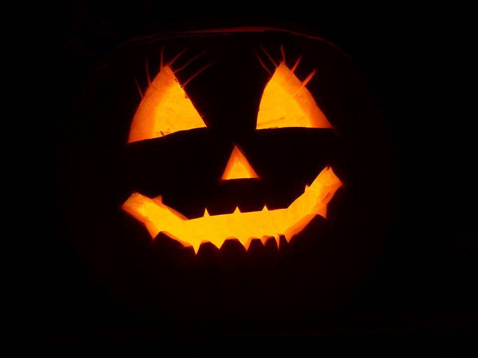 An illuminated smiling jack-o-lantern